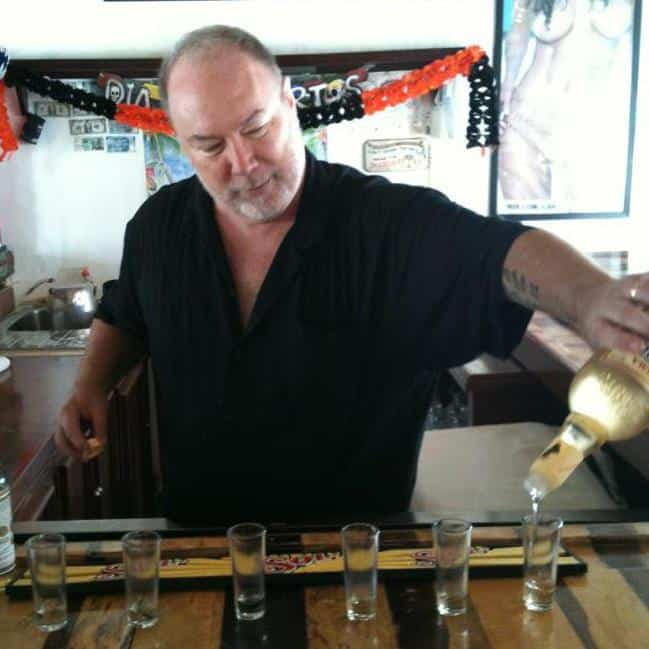 Expat in Mexico - pouring tequila